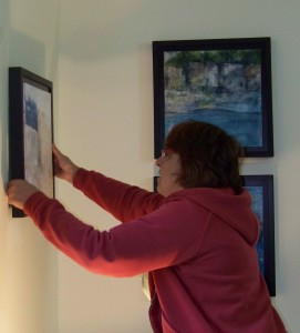 Hanging paintings for the studio tour.